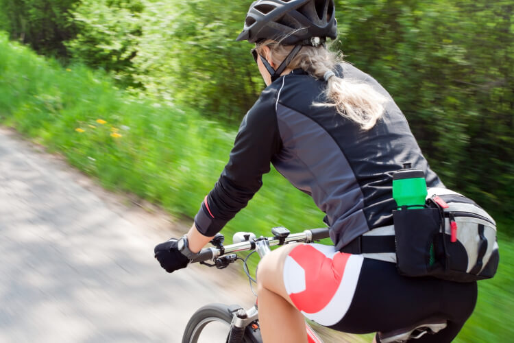 Woman riding bicycle with proper form
