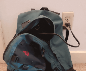 charging electric bike battery in backpack