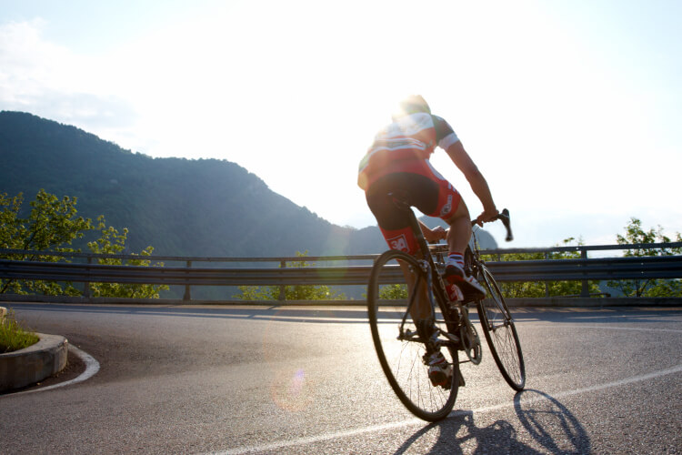 Man riding road bike uphill